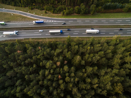 Aerial view of a highway amid fields with cars on it Stock Photo - 81488828