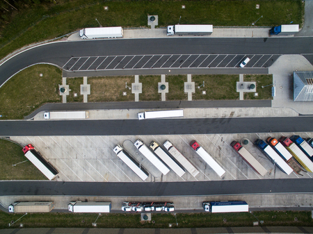 Aerial view of a highway amid fields with cars on it Stock Photo - 81488841