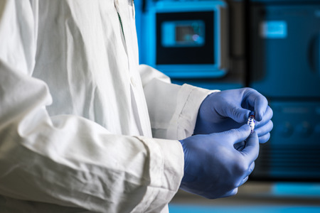 Hands of a researcher carrying out scientific research in a lab