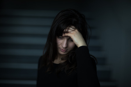 pullovers: Young woman suffering from severe depressionanxiety
