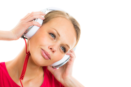 Pretty, young woman listening to her favorite music on hi-fi headphones, dancing, enjoying the tune, having a moment for herself Standard-Bild