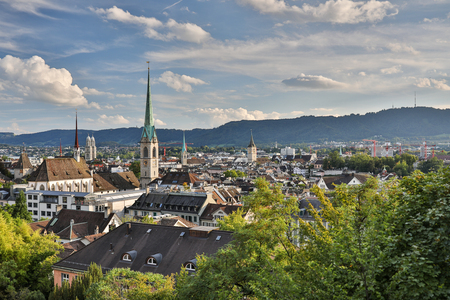 Aerial view of Zurich city center with famous St. Peter Church and river Limmat at Lake Zurich from Grossmunster Church Canton of Zurich Switzerland