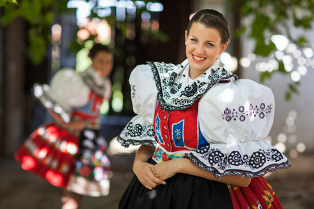 Keeping tradition alive: young woman in a richly decorated ceremonial folk dressregional costume (Kyjov folk costume, Southern Moravia, Czech Republic) Standard-Bild
