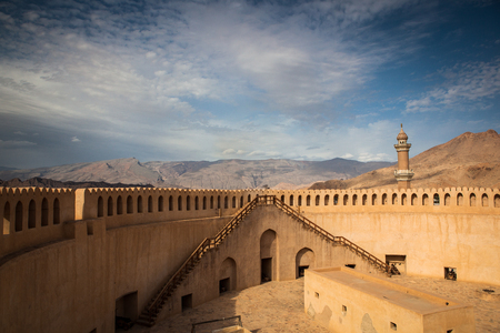 Stunning view of the Nizwa fort surrounded by mountains (Ad Dakhiliyah, Oman)