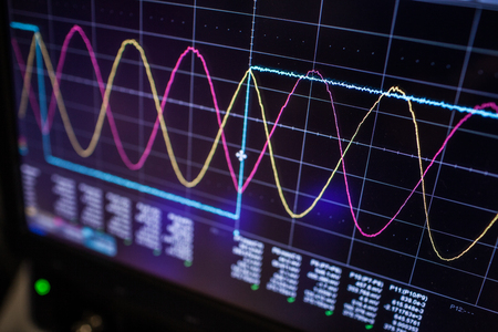 Digital oscilloscope is used by an experienced electronic engineer in the laboratory