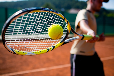 Tennis player in action on a tennis court
