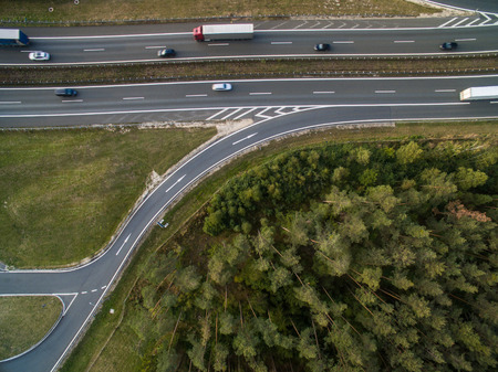 Aerial view of a highway amid fields with cars on it Stock Photo - 96602285
