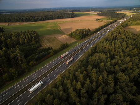 Aerial view of a highway amid fields with cars on it Stock Photo - 97067749