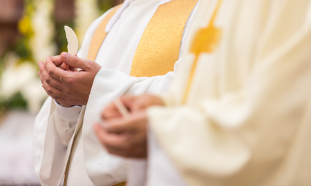 Priest during a wedding ceremonynuptial mass (shallow DOF; color toned image)