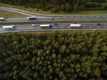 Aerial view of a highway amid fields with cars on it Stock Photo - 99361765
