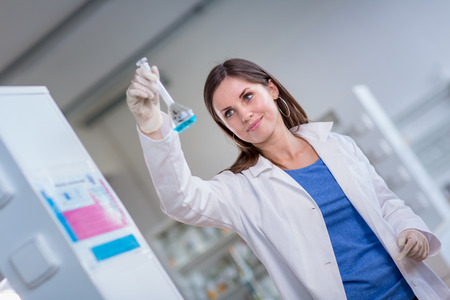 Portrait of a female chemistry student carrying out research in a chemistry lab