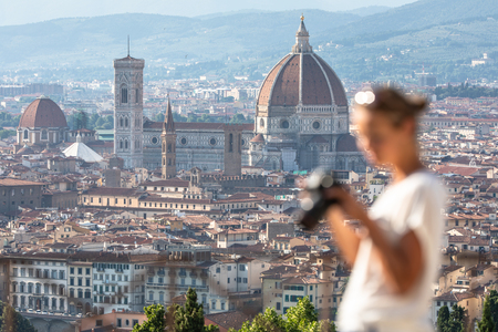 Splendid Florence, Italy, with out of focus female photographer in the foreground