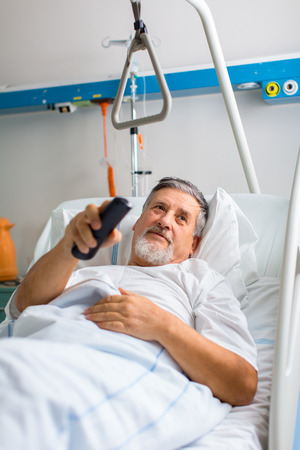 Senior male patient in a modern hospital (shallow DOF; color toned image) Stock Photo