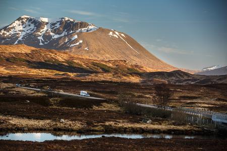 Open road leading through Glencoe, Scottish Higland, Scotland, UK