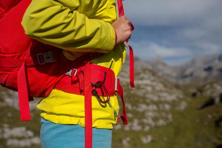 Pretty, young female hiker walking in high mountains (shallow DOF) Standard-Bild - 108975668