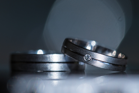 Wedding day details - two lovely wedding rings awaiting their moment Banco de Imagens