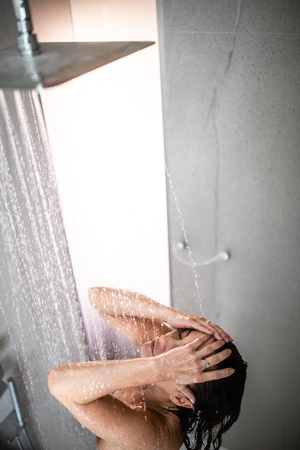 Pretty, young woman in shower Standard-Bild