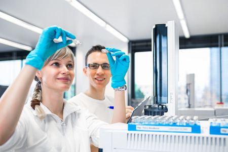 senior male researcher carrying out scientific research in a lab using a gas chromatograph (shallow DOF; color toned image) Stock fotó