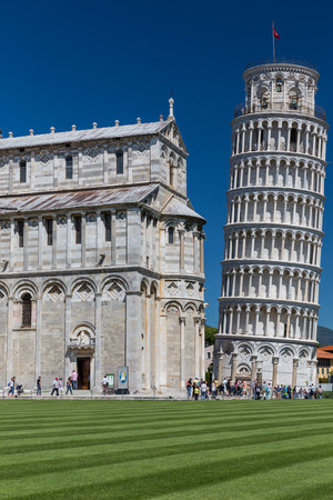 Crowds of tourists visiting the Leaning Tower of Pisa, Tuscany, Italy (motion blur technique used to convey the incessant influx of tourist to this landmark)