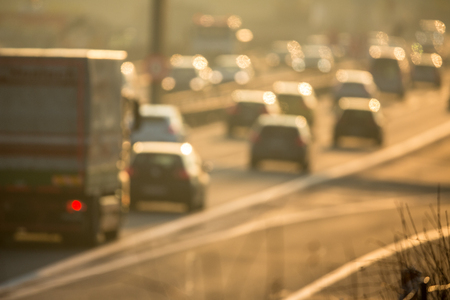 Heavy morning city trafficcongestion concept - cars going very slowly in a traffic jam during the morning rushhour - blurred photo Stock Photo