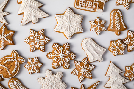 Big set Christmas gingerbread: gingerbread houses, crescent, gingerbread man, snowflakes, sock, Christmas tree, bell, star, new years ball on white background Stock Photo