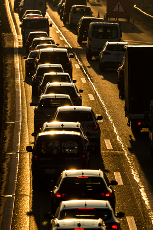 Heavy morning city traffic/congestion concept - cars going very slowly in a traffic jam during the morning rushhour Foto de archivo - 115346722