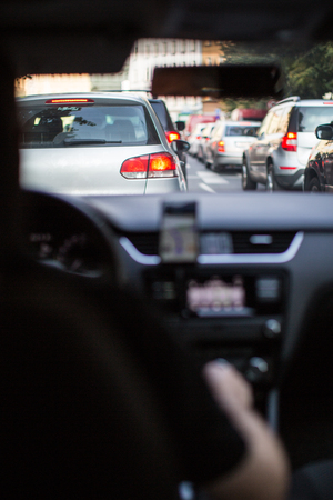 Traffic jam in a city with row of cars on the  road during rush hour Stock Photo
