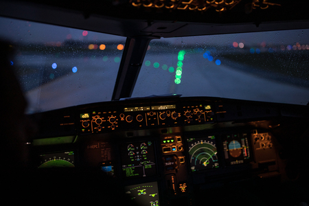 Pilots hand accelerating on the throttle in  a commercial airliner airplane flight cockpit during takeoff Stock fotó