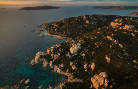 Scenic Sardinia island landscape. Italy sea coast with azure clear water. Nature background. Aerial image with warm evening light.
