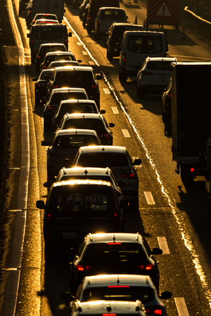 Heavy morning city trafficcongestion concept - cars going very slowly in a traffic jam during the morning rushhour Stockfoto