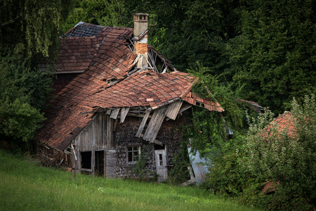 Splendid villa with lots of potential (a realtor would say) - House falling apart amid greenery Stock Photo