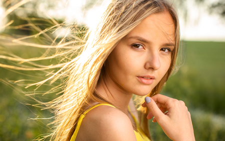 Portrait of young  woman with radiant clean outdoor on a spring/summer sunny day Banco de Imagens