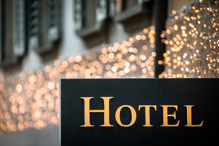 Hotel sign at dusk - Illuminated hotel sign in Paris at night;  vacation accomodation and travel concept Stock Photo