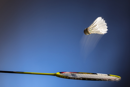 Badminton racket and shuttlecock  in motion closeup Stock Photo