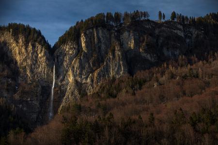 High waterfall within alpine scenery in Switzerland 版權商用圖片 - 121290067