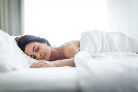 Beautiful young woman sleeping in bed Banco de Imagens - 126195761