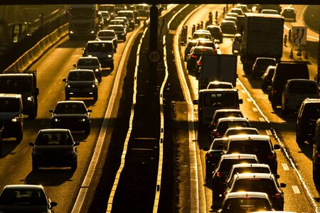 Heavy morning city traffic/congestion concept - cars going very slowly in a traffic jam during the morning rushhour