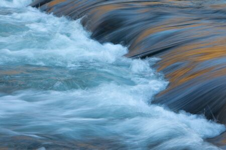 Water concept - river water flowing with light reflecting of its surface - long exposure shot Stock fotó - 126735371
