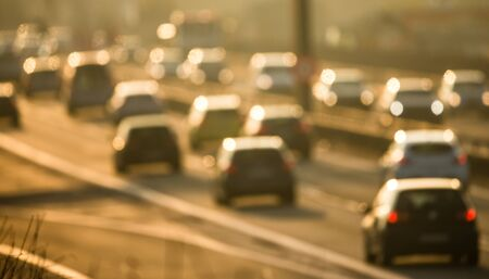 Heavy morning city trafficcongestion concept - cars going very slowly in a traffic jam during the morning rushhour - blurred photo Stockfoto