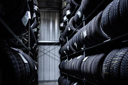 Tyres being stored in a garage - waiting for the client to have them put on his car 版權商用圖片
