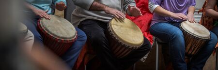 Group of people playing on drums - therapy by music Stock fotó