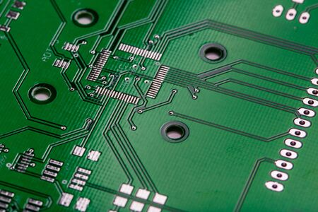 Printed green computer circuit board with many electrical components