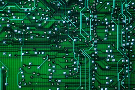Printed green computer circuit board with many electrical components Banque d'images