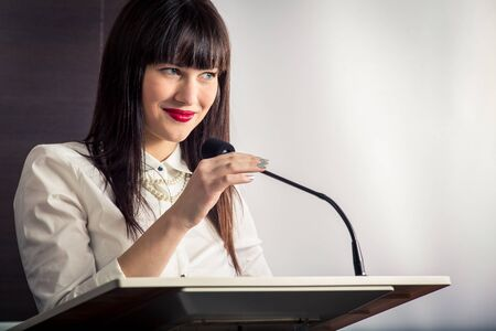 Pretty, young business woman giving a presentation in a conferencemeeting setting (shallow DOF; color toned image) Stock fotó