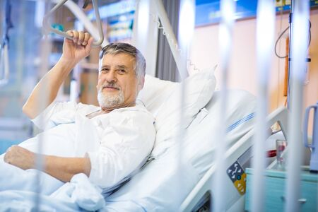 Senior male patient in a modern hospital (shallow DOF; color toned image) Imagens