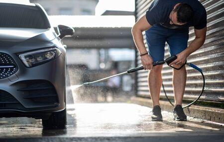 Man washing Car in a car wash