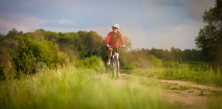 Female cyclist outdoors on her mountain bike