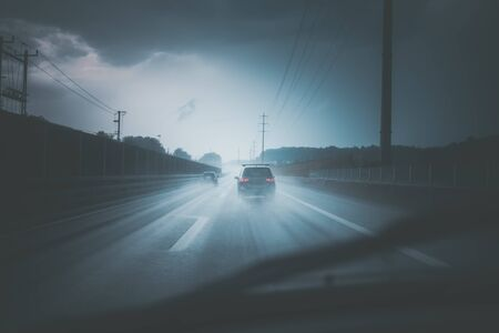 Cars on a highway at a rainy dusk (shallow DOF; color toned image)