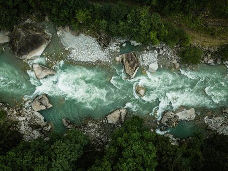 Aerial top view of a splendid mountain river in Swiss Alps 스톡 콘텐츠