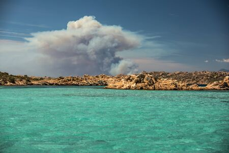 Scenic Sardinia island landscape with Corsica burning in distance - Sardinia sea ​​coast with azure clear water
